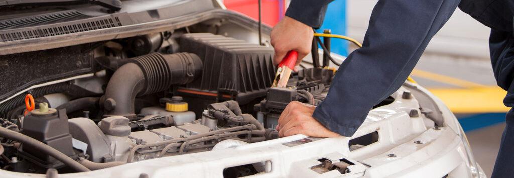 Mechanic checking battery
